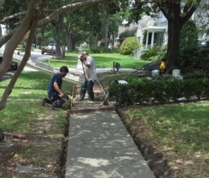 image of crew removing trip hazard concrete sidewalk